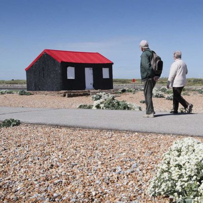 Visitors passing the Red Hut