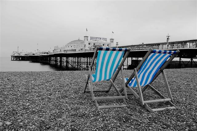 Blue Deckchairs by Brighton Pier