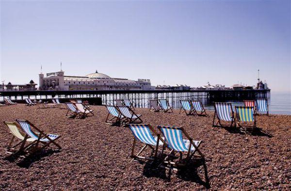 Deckchairs by Brighton Pier