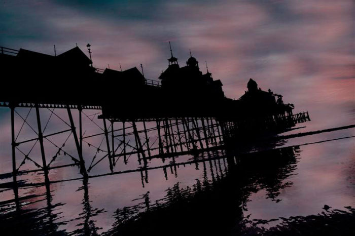 Eastbourne Pier in shadow