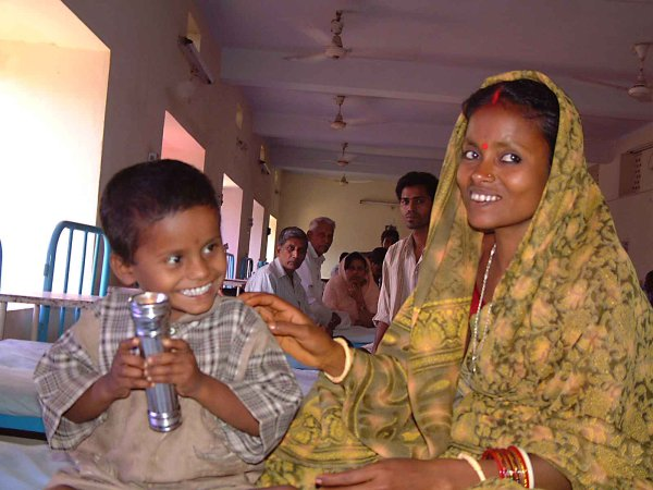 Mother & son waiting in a Sight Savers eye camp