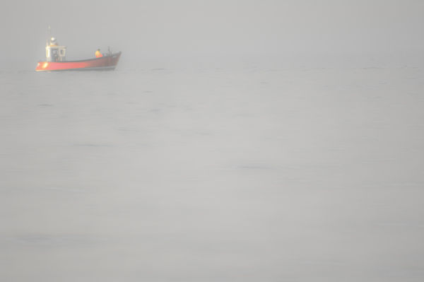 Red boat in the mist