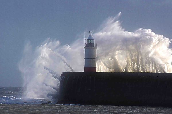 Waves over Newhaven lighthouse