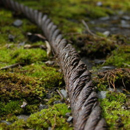 Rusty steel rope in a car park,Farsley, Leeds.