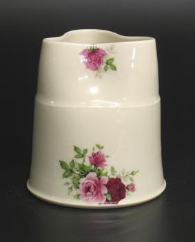 Thrown porcelain flower vase. 15cm (approx).