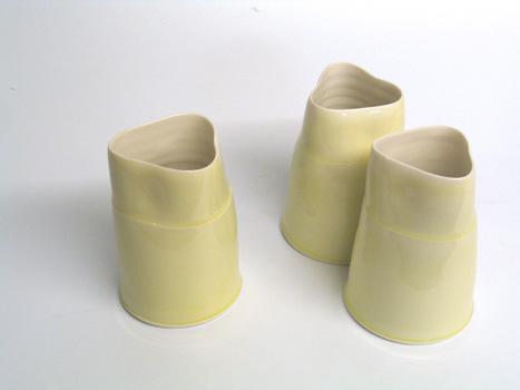 Thrown porcelain flower vase group. 15cm (approx).