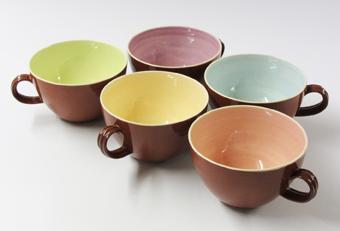 Pale colours terracotta cups