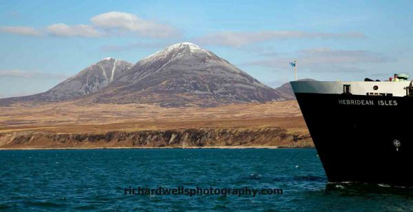 The ferry arriving at Port Askaig with the paps of Jura in the background
