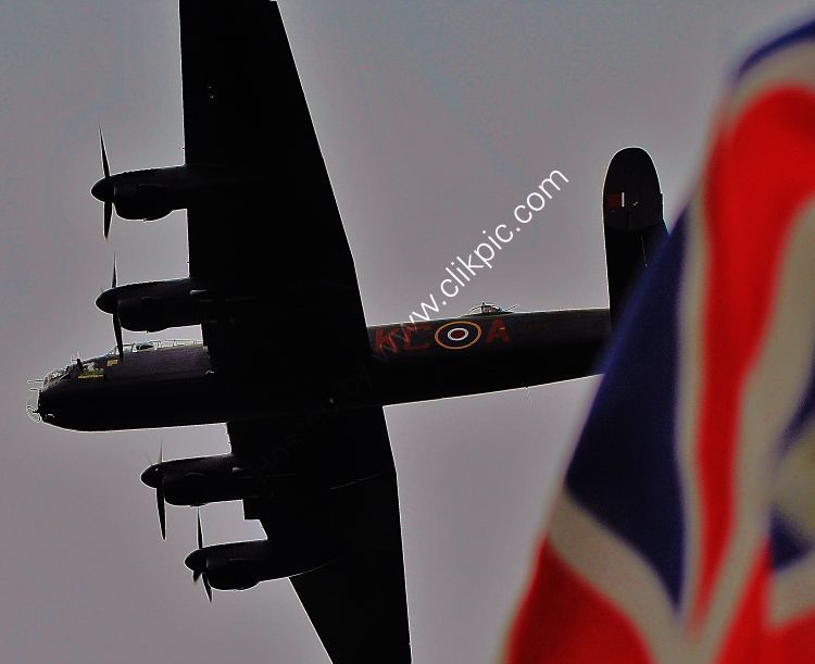 Ref ALT91 Avro Lancaster B1 PA474 Battle Of Britain Memorial Flight Flying Over The Union Flag Bournemouth Air Show Hampshire GB 2014 (C) RLT Aviation And Maritime Images 201