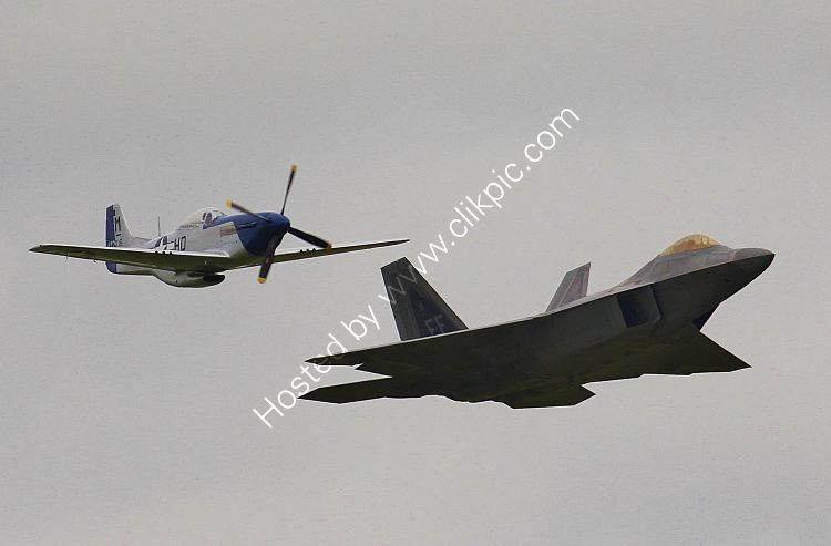 Ref GMJ-33 Lockheed Martin F22 Raptor USAF 09-191 And NA P51D Mustang USAAF Private Owner 44-72216 G-BIXL Duxford Aerodrome Cambridgeshire GB 2016 (C)RLT Aviation And Maritime Imaes 2018 opt
