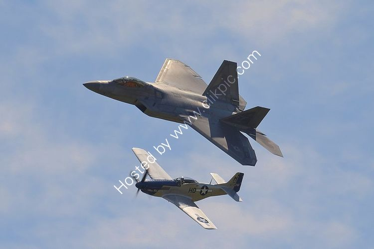 Ref GMJ-45 Lockheed Martin F22 Raptor USAF 09-191 and NA P51D Mustang USAAF Private Owner 44-72216 G-BIXL Duxford Aerodrome Gt Britain 2016 (C)RLT Aviation And Maritime Images 2018 opt