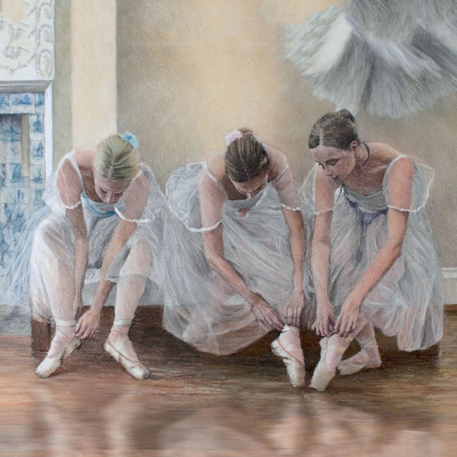 Ballerinas tying pointe shoes