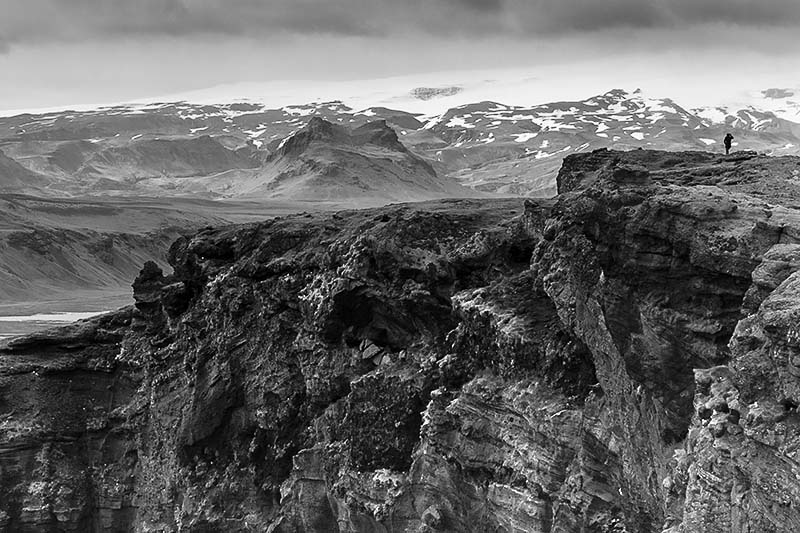 Black and whiteCliff  and distant Glacier