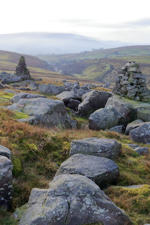 Stone men on Bolton Haw Crags, Hebden Gill, on a misty day in winter