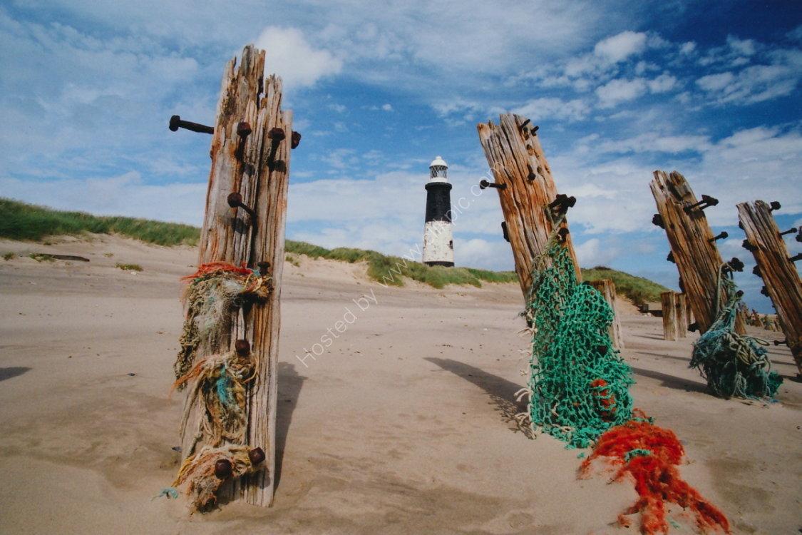 Lighthouse, nets, dunes, groynes at Spurn Point