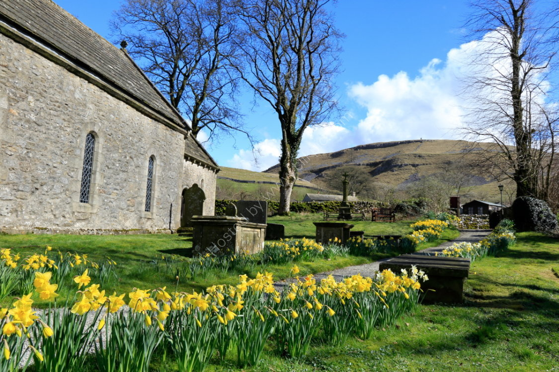 Conistone church with daffodils