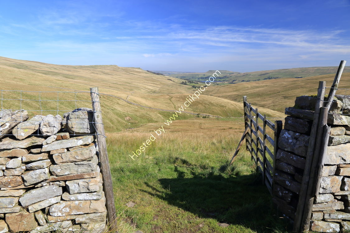 Gate in drystone wall with view of Addlebrough and Semerwater from Bardale