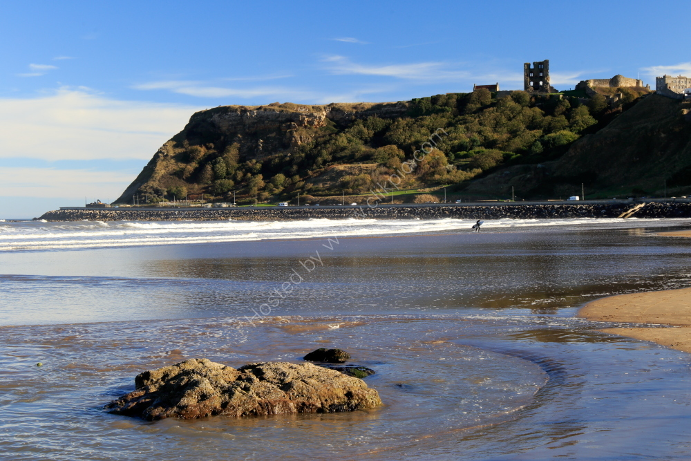 Scarborough Castle and Scarborough North Bay at low tide, winter