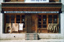 Army uniforms drying on doors of bank, Leh