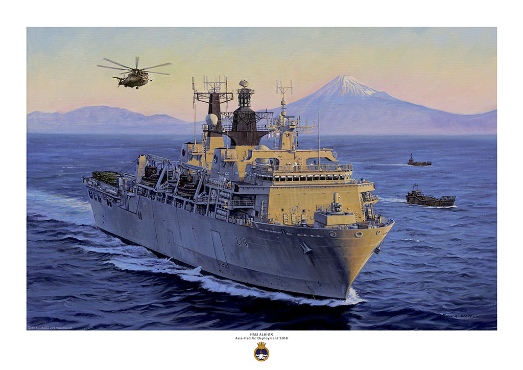 HMS Albion at sea with Mount Fuji in the background and the sun going down.