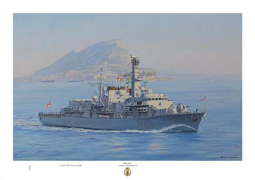 HMS Kent off Gibrlatar on a misty sunny day with calm blue sea.