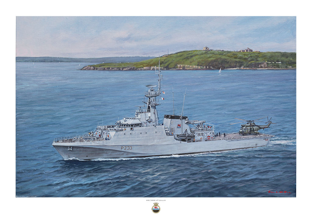 HMS Tamar port side aerial view with Puma helicopter on deck and Falmouth on the horizon