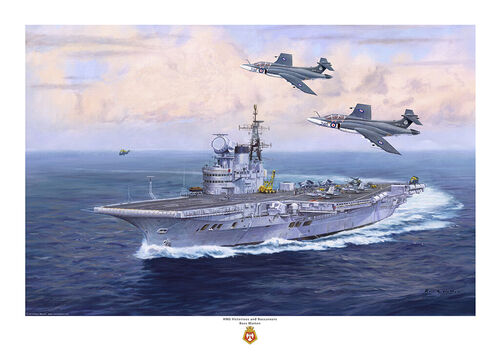 HMS Victorious turning to starboard viewed from the port bow with two of her Buccaneer S2 jets passing overhead.