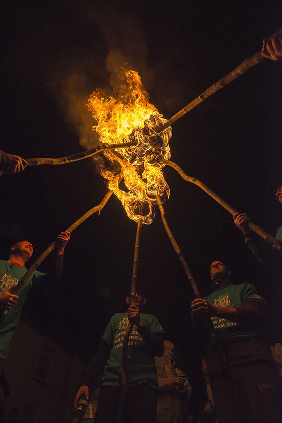 Lighting torches (Hatherleigh).