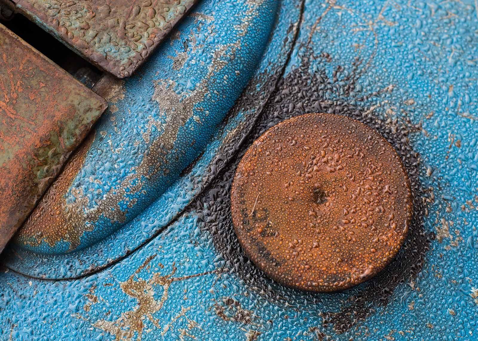 Dew on old tractor filler cap.