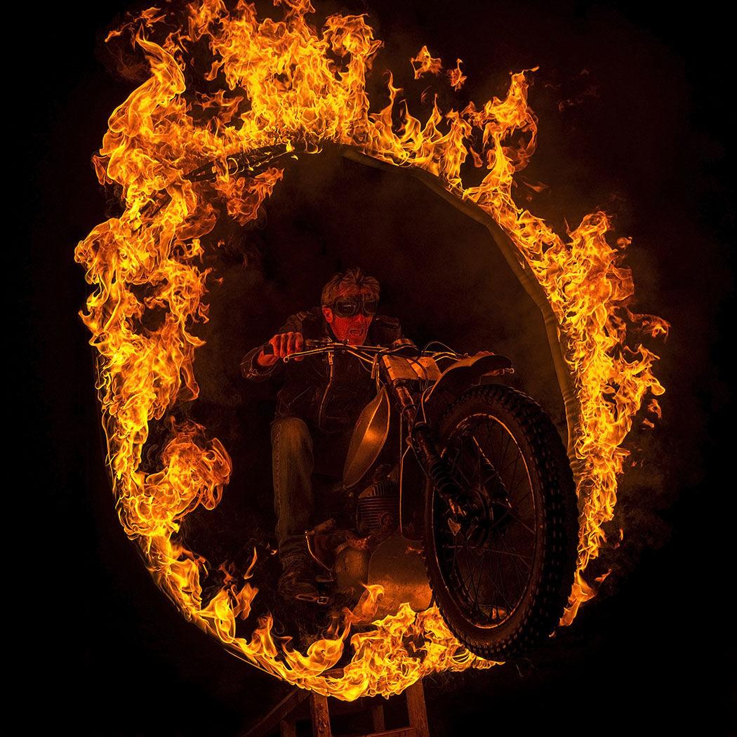 Biker fire hoop jump