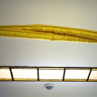 Close up of Arca Dei and one of the original Art Deco light fittings in the stairwell leading to the Terarken Rooms