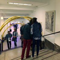 Visitors to ACAF 2018 looking at the detail of the supporting works