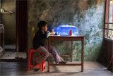 Boy having tea Lake Inle Myanmar