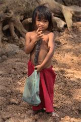 Child with bean pod Vietnam