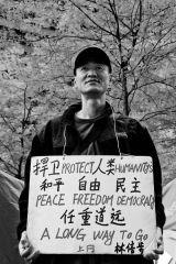 Demonstrator representing the Chinese Community