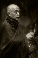 Monk collecting alms - Yangon