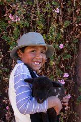 Alexandra with his pet lamb - LLachon Community Lake Titicaca