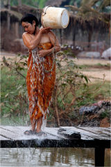 Woman washing in the river, Cambodian village Angkor
