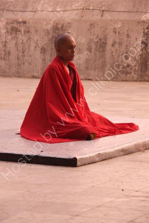 Monk Praying at Sunrise