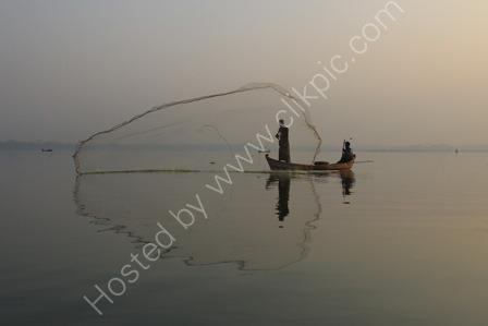 Fisherman with net on Lake