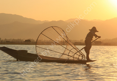 Fisherman in the Setting Sun