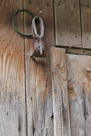 Old Farm Implements on Barn Wall