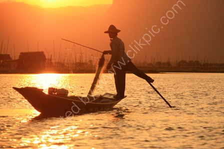 Leg Rowing Fisherman at Sunset