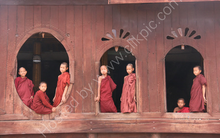 Monks in Teak Monastery