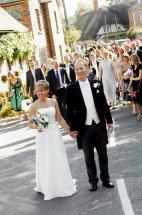 Paula Matt and guests walk to the reception