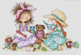 Girls playing with teddies and dolls