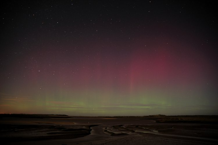Aurora Borialis or Northern Lights over Scolt Head and Gun Hill
