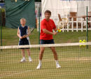 Pat Cash coaching a young Connor Mollison