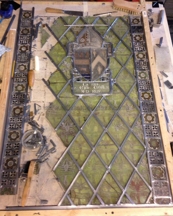 Re-glazing pressed quarry window