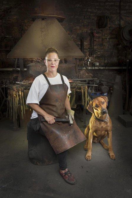 Female Blacksmith Katie Latham and her workshop companion.